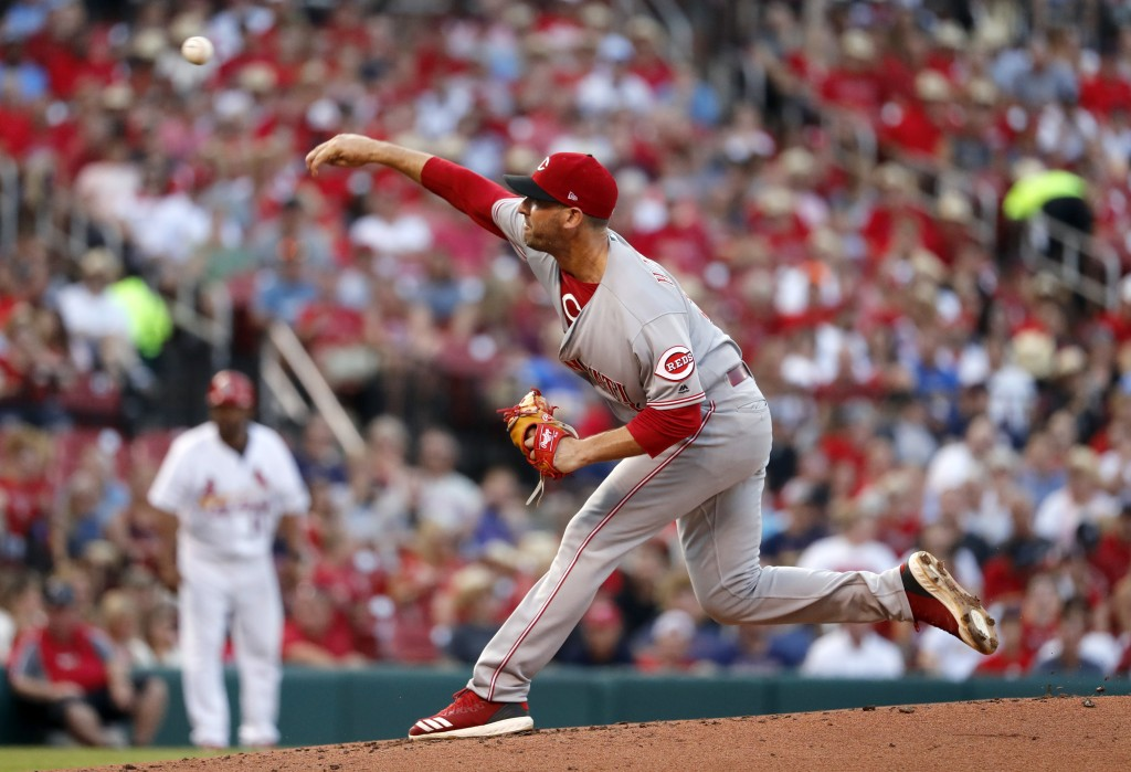Cincinnati Reds starting pitcher Matt Harvey throws during the first inning of the team's baseball game against the St. Louis Cardinals on Friday, Jul
