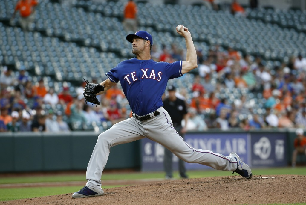 Texas Rangers starting pitcher Cole Hamels throws to the Baltimore Orioles in the first inning of a baseball game, Friday, July 13, 2018, in Baltimore