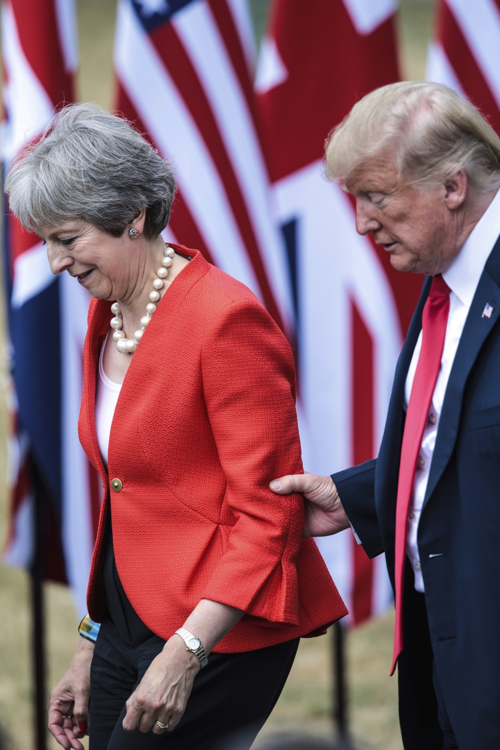 British Prime Minister Theresa May, left and U.S. President Donald Trump attend a joint press conference following their meeting at Chequers, in Bucki...