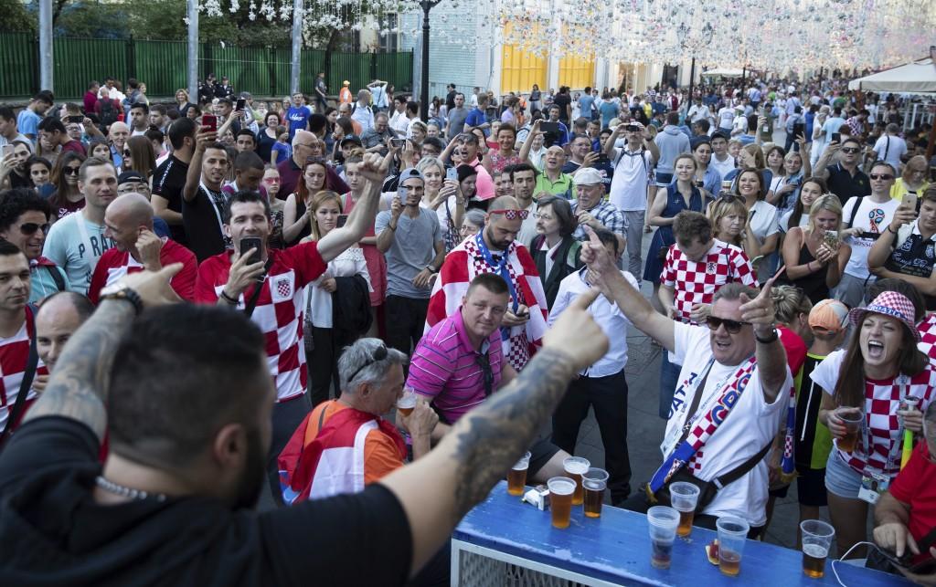 Croatia's soccer fans cheer as they meet in Nikolskaya street near the Kremlin in Moscow, Russia, Friday, July 13, 2018. (AP Photo/Pavel Golovkin)