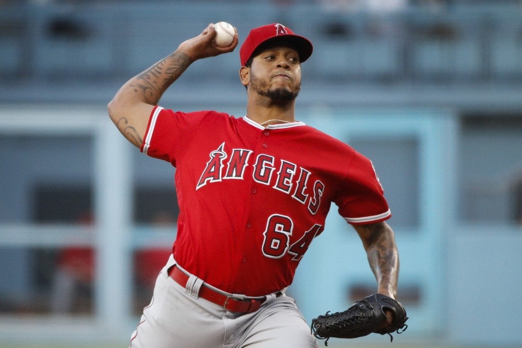 Los Angeles Angels starting pitcher Felix Pena throws against the Los Angeles Dodgers during the first inning of a baseball game, Friday, July 13, 201