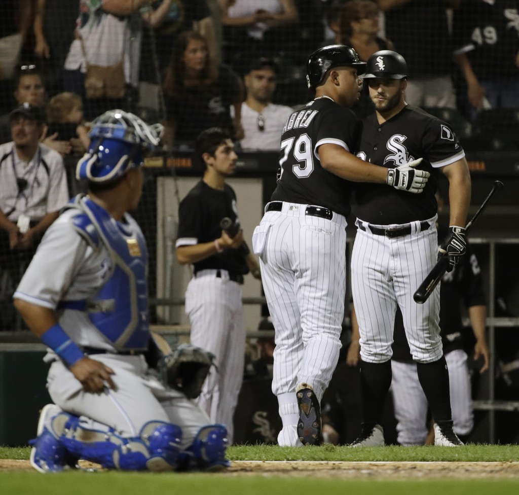 Chicago White Sox's Jose Abreu (79) celebrates with Daniel Palka after hitting a solo home run during the sixth inning of a baseball game against the