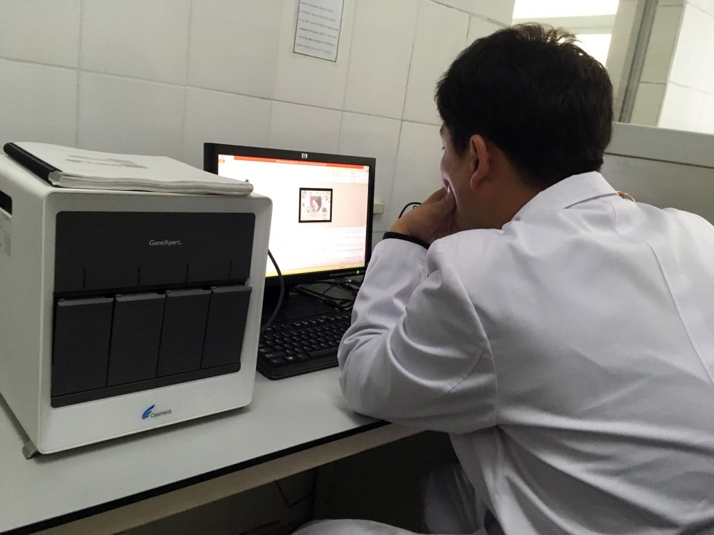 In this May 7, 2018, photo, a staffer works at a laptop next to an American-made GeneXpert machine used to diagnose tuberculosis at the National Tuber