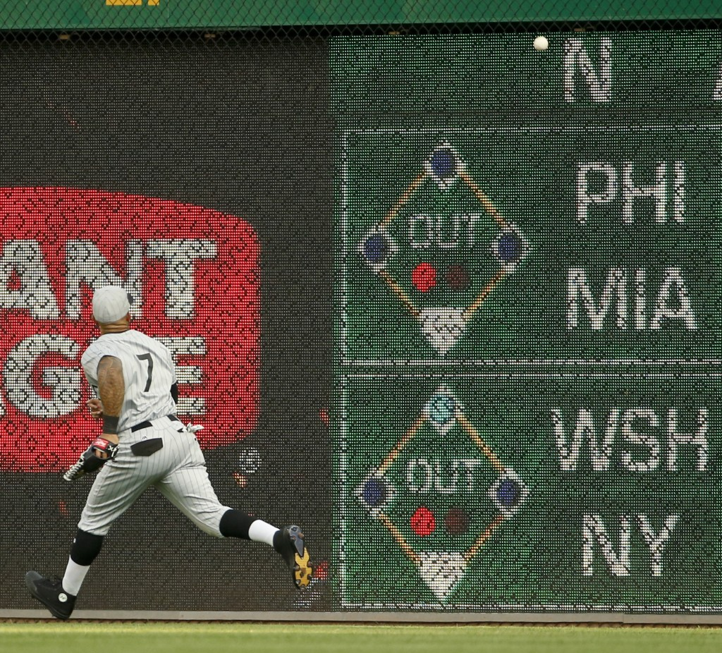 Milwaukee Brewers right fielder Eric Thames chases a fly ball by Pittsburgh Pirates' Corey Dickerson that went for a double off the wall during the fi