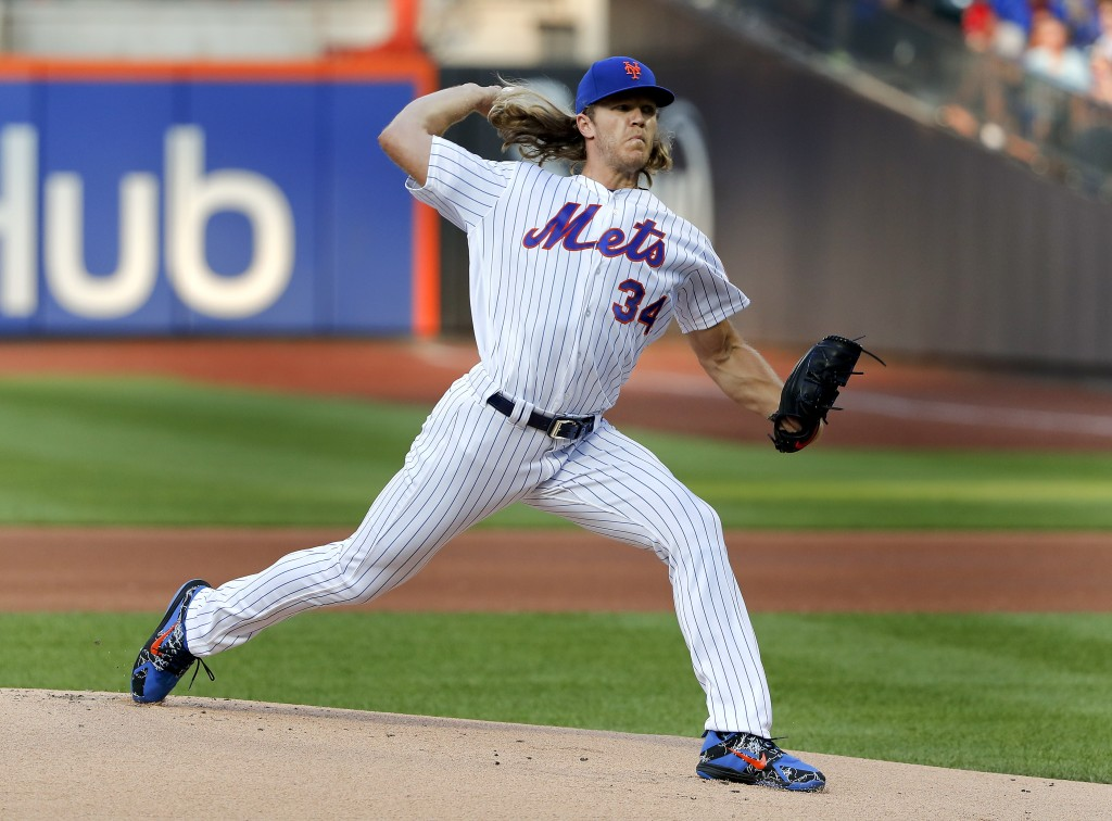 New York Mets starting pitcher Noah Syndergaard (34) delivers against the Washington Nationals during the first inning of a baseball game, Friday, Jul