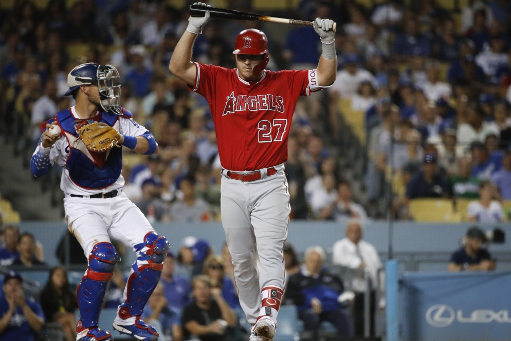 Los Angeles Angels' Mike Trout reacts after striking out during the fifth inning of a baseball game against the Los Angeles Dodgers, Friday, July 13,