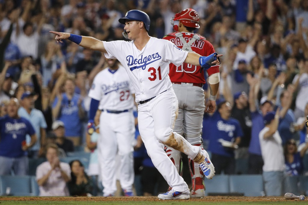 Los Angeles Dodgers' Joc Pederson celebrates after scoring against the Los Angeles Angels during the seventh inning of a baseball game Friday, July 13