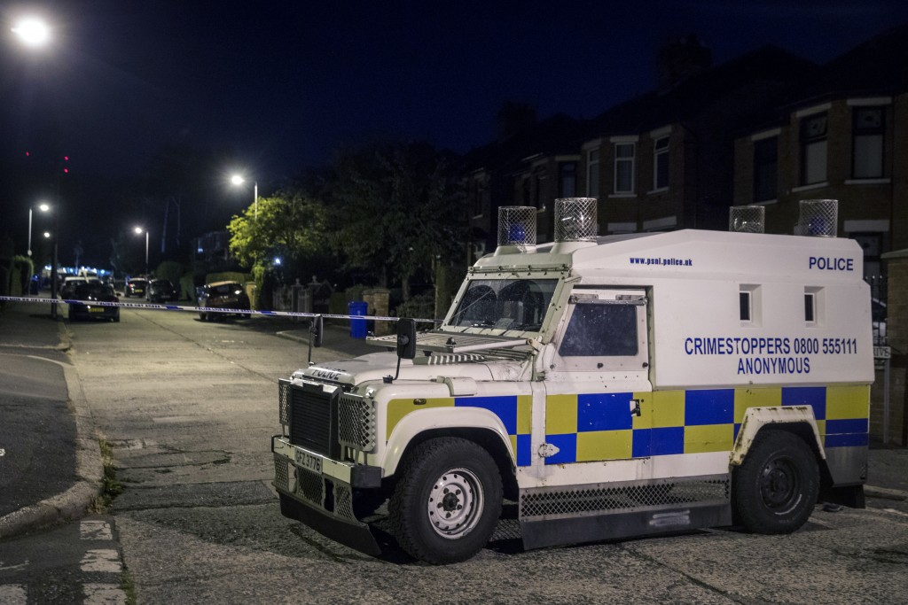 Police at the scene of an explosive device attack on the home of former Sinn Fein leader Gerry Adams, in West Belfast, Northern Ireland, early Saturda...