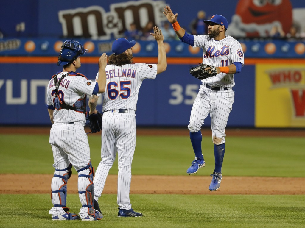 New York Mets right fielder Jose Bautista (11) celebrates with relief pitcher Robert Gsellman (65) and catcher Devin Mesoraco (29) after they dfefeate