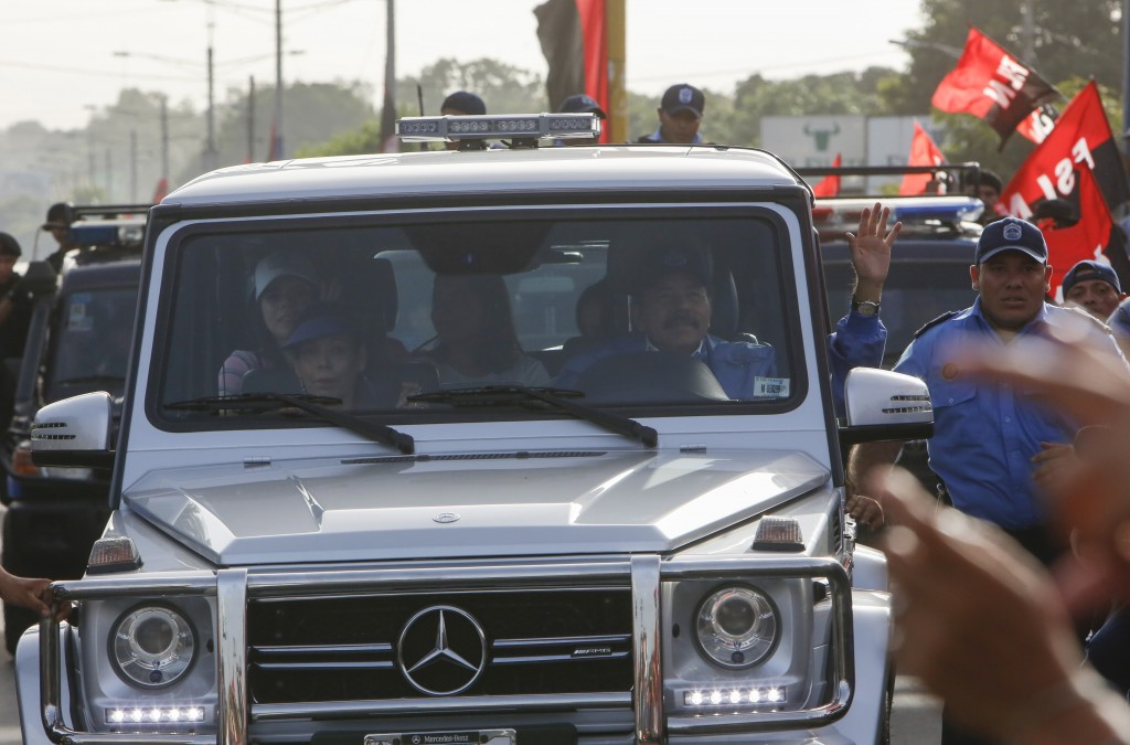 Nicaraguan President Daniel Ortega and his wife, Vice President Rosario Murillo arrive with a heavy police escort into Masaya, Nicaragua, Friday, July