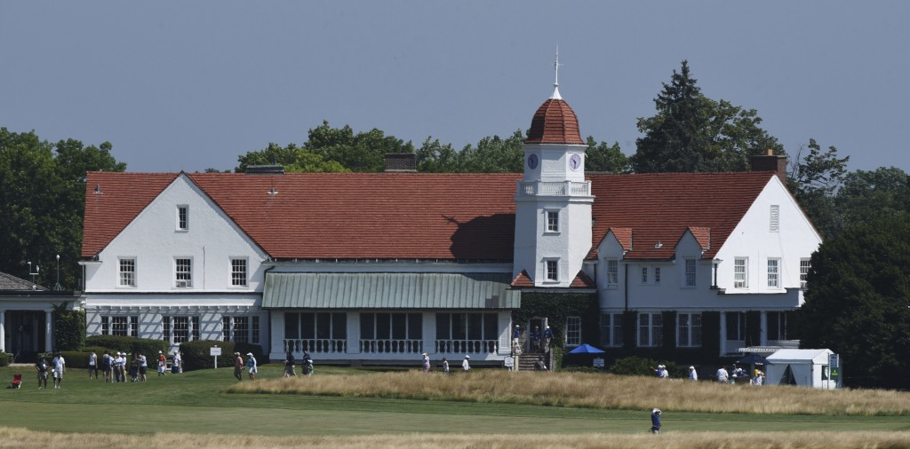 The clubhouse is viewed from the 11th green during the second round of the inaugural U.S. Senior Women's Open golf tournament in Wheaton, Ill., Friday