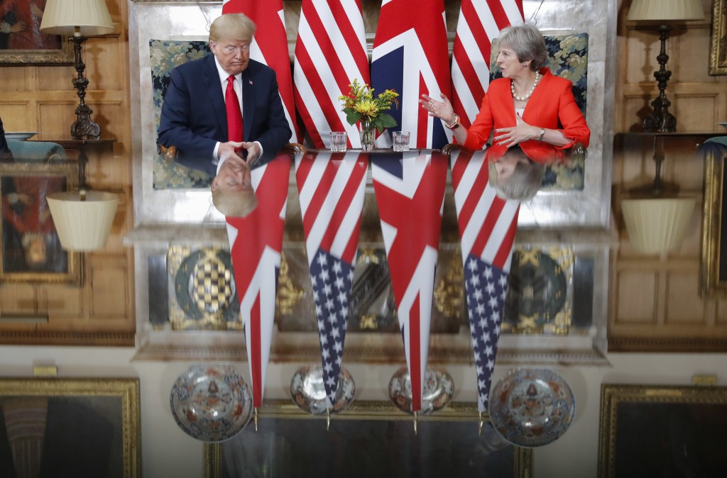 U.S. President Donald Trump, left, listens to British Prime Minister Theresa May, right, speak during their meeting at Chequers, in Buckinghamshire, E
