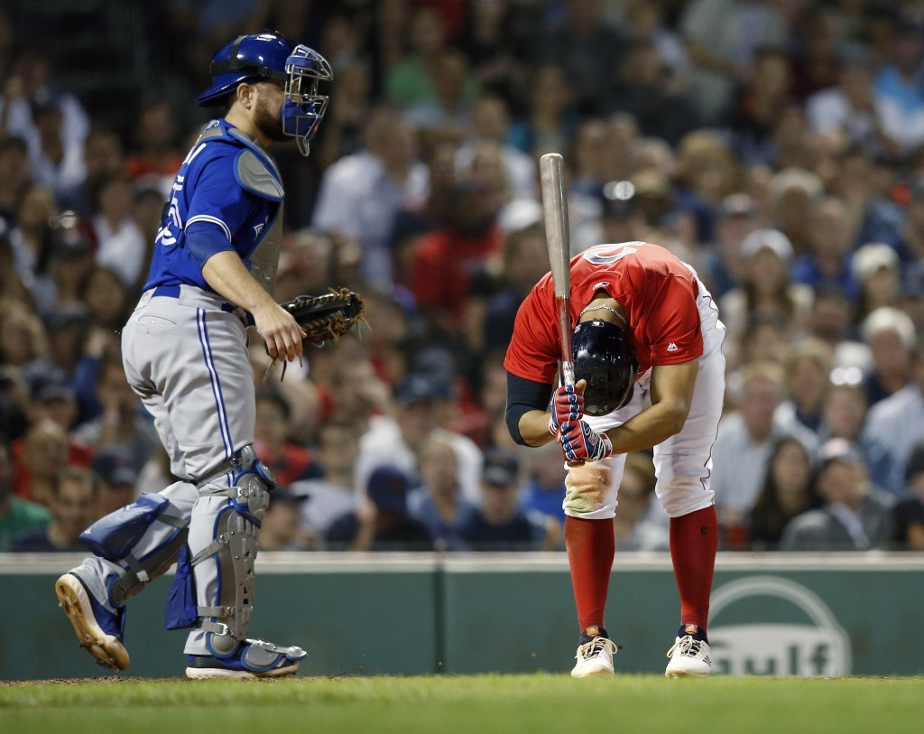 Boston Red Sox's Xander Bogaerts, right, reacts in front of Toronto Blue Jays' Russell Martin after striking out during the fifth inning of a baseball