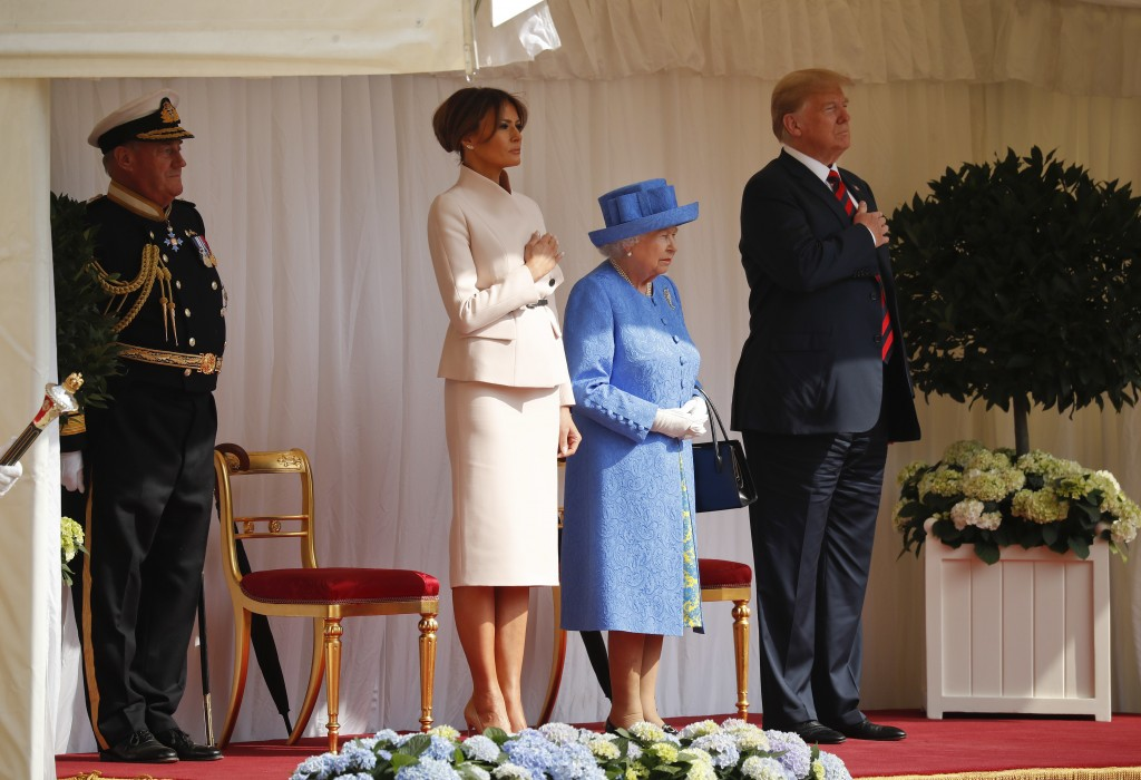 Queen Elizabeth II, with President Donald Trump, right, and first lady Melania Trump participate in the arrival ceremony at Windsor Castle, Friday, Ju