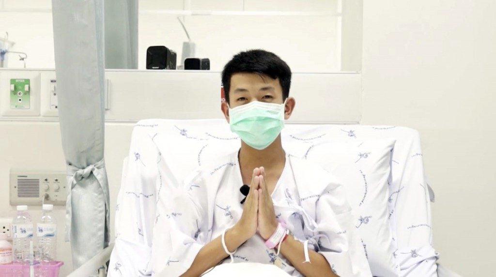 This image made from a video taken on July 13, 2018 and released by Chiang Rai Prachanukroh Hospital, shows Pornchai Kamluang, one of the 12 boys resc