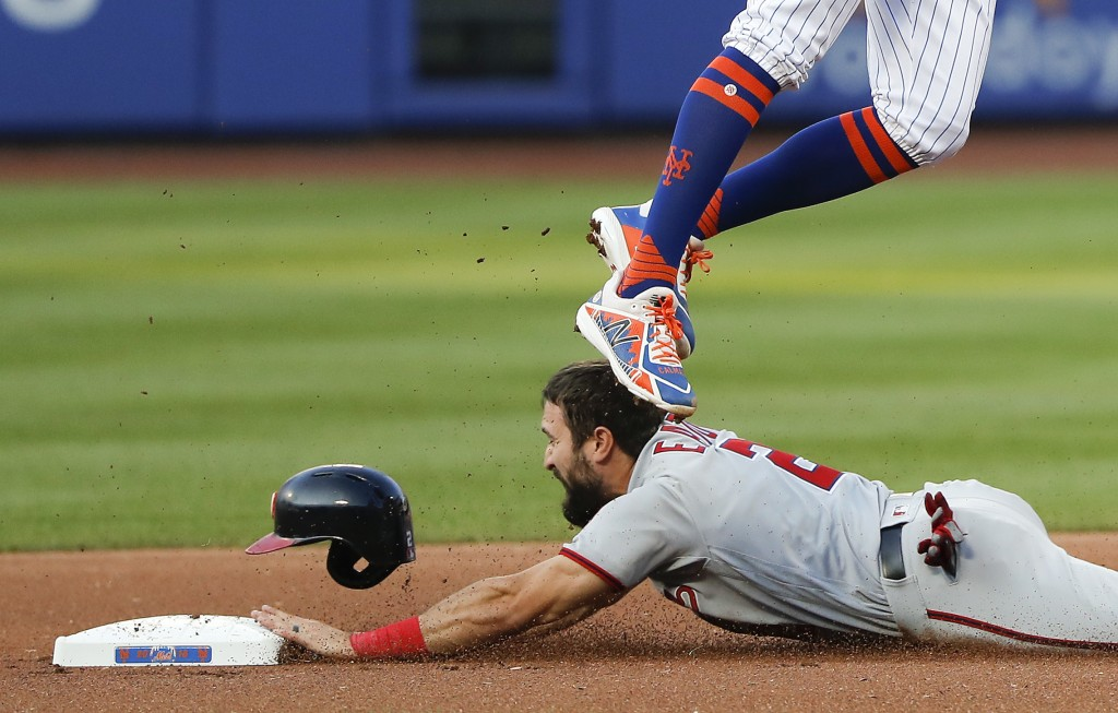Washington Nationals' Adam Eaton (2) steals second base as the throw to New York Mets shortstop Amed Rosario goes high during the first inning of a ba