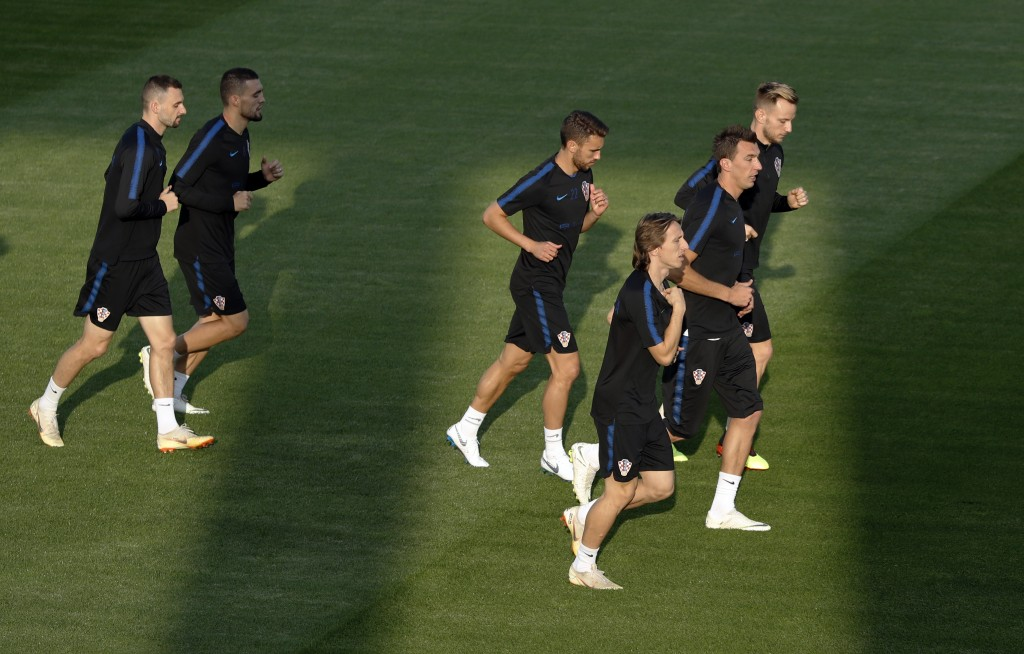 Croatia players warm up during a training session of Croatian national team at the 2018 soccer World Cup in Moscow, Russia, Friday, July 13, 2018. (AP