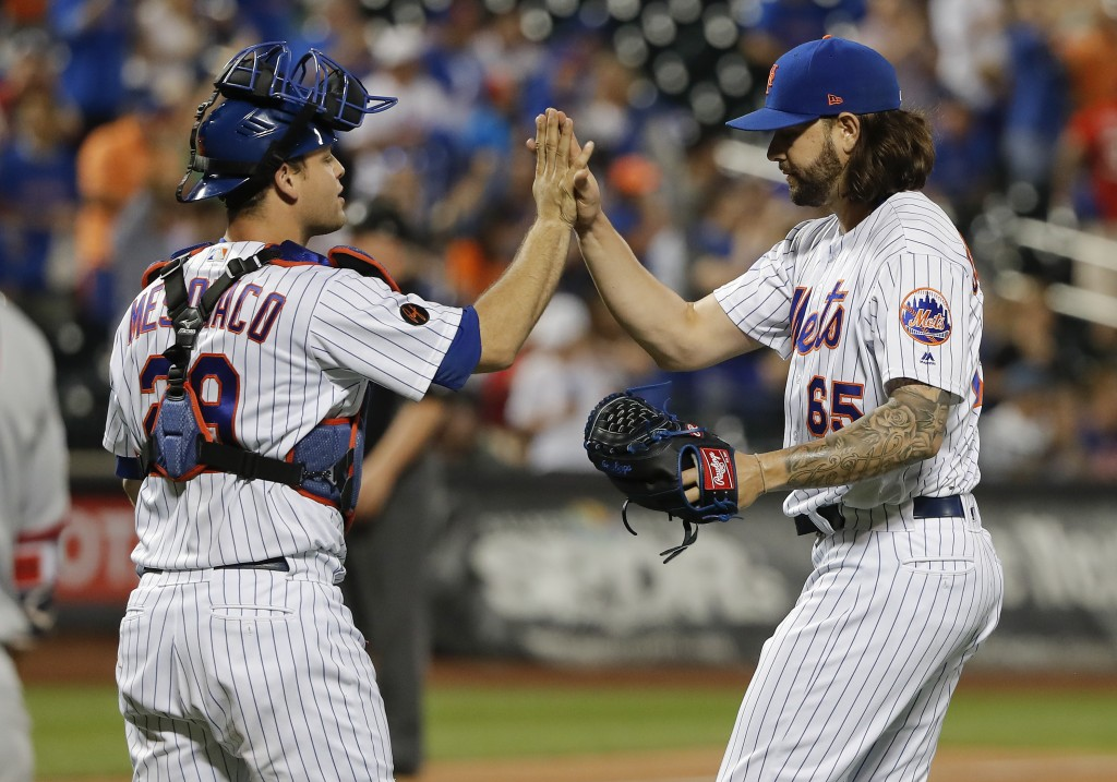 New York Mets relief pitcher Robert Gsellman (65) celebrates with catcher Devin Mesoraco (29) after they defeated the Washington Nationals in of a bas