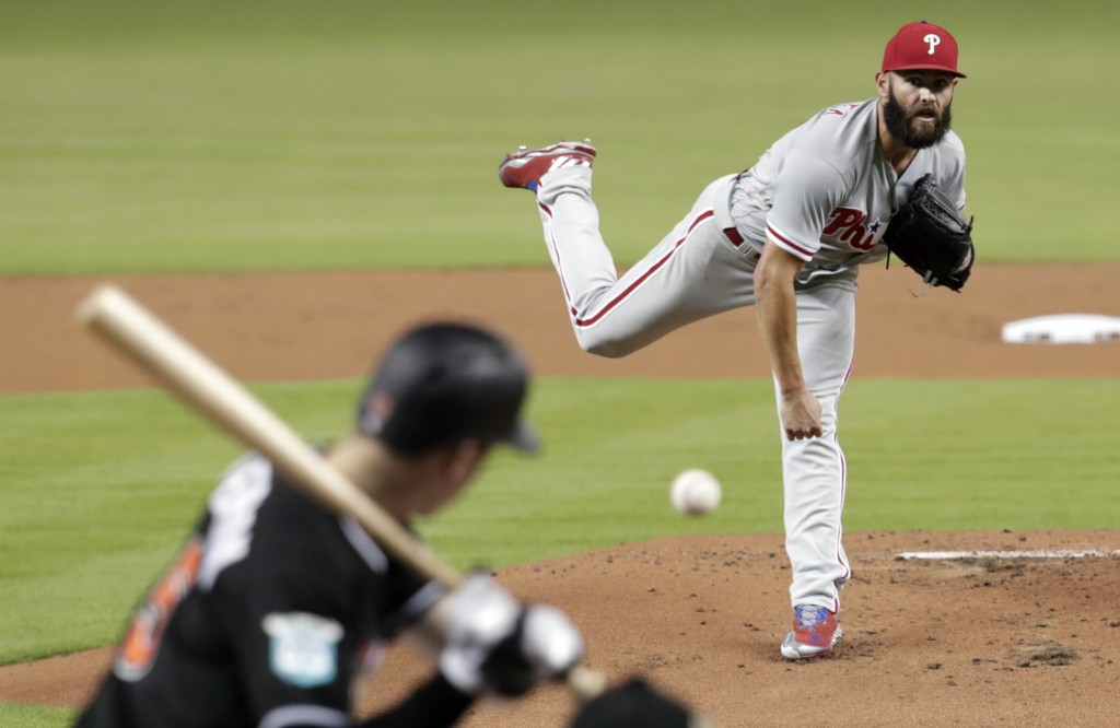 Philadelphia Phillies starting pitcher Jake Arrieta delivers during the first inning of the team's baseball game against the Miami Marlins, Friday, Ju