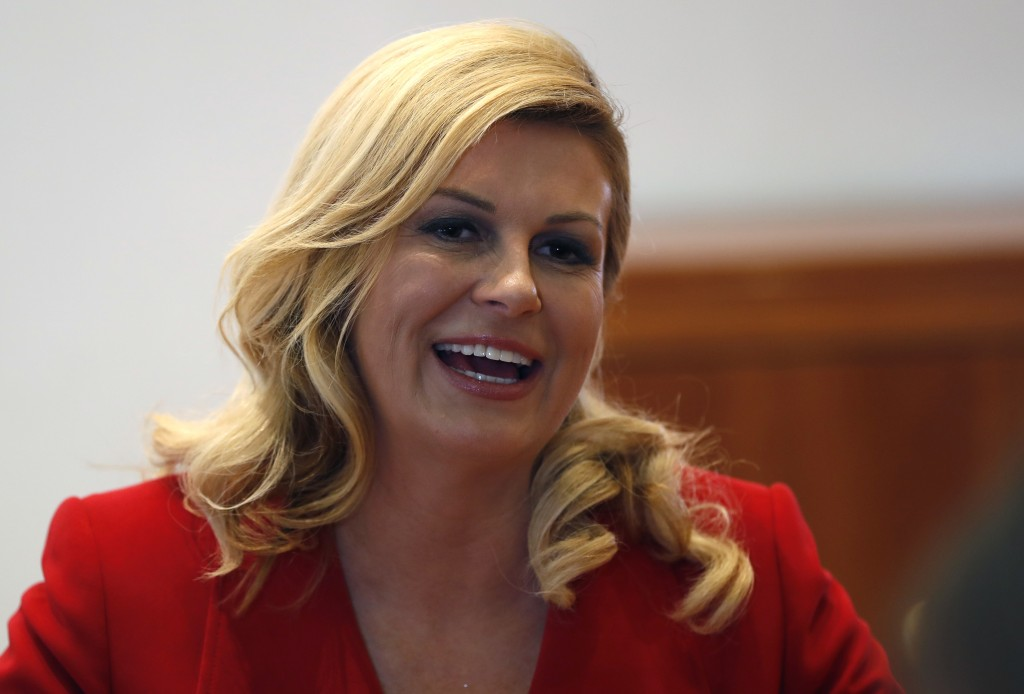 Croatian President Kolinda Grabar Kitarovic smiles durning an interview with the Associated Press at the 2018 soccer World Cup at the Croatian embass
