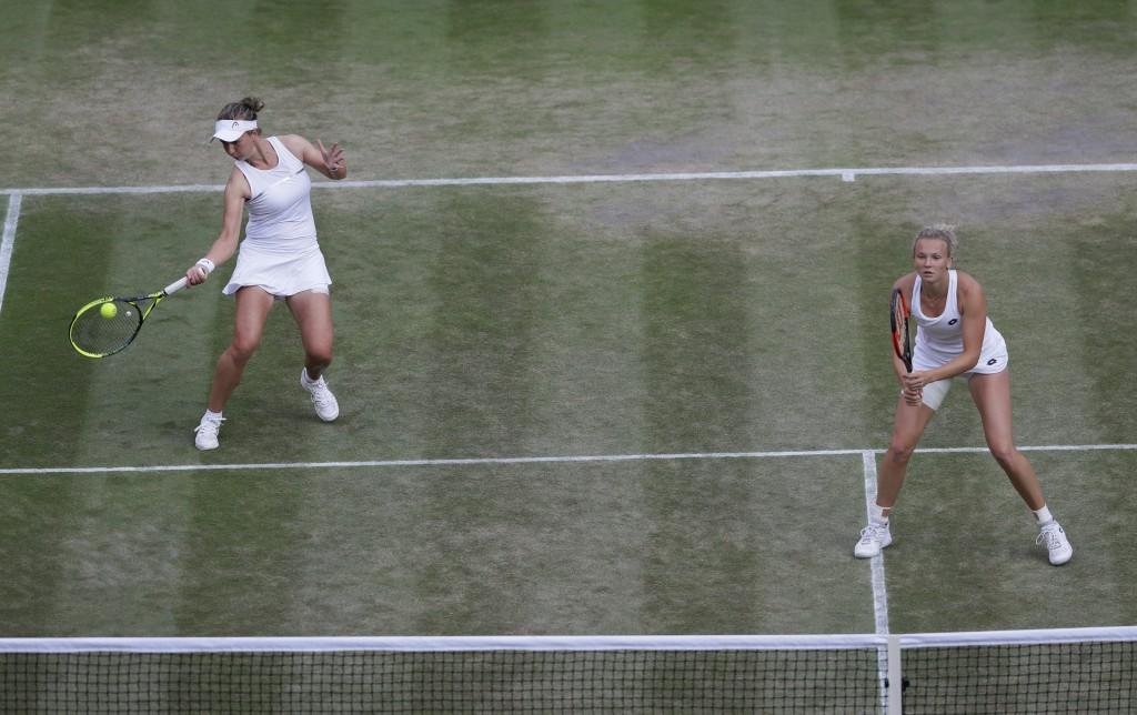 Katerina Siniakova of the Czech Republic, right, and Barbora Krejcíkova of the Czech Republic return the ball to Nicole Melichar of the US and Kveta P...