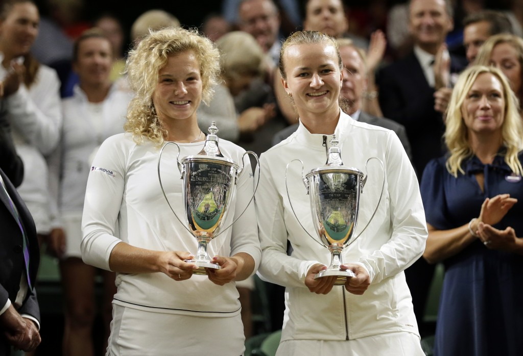 Katerina Siniakova of the Czech Republic, left, and Barbora Krejcíkova of the Czech Republic hold up their trophies after defeating Nicole Melichar of...