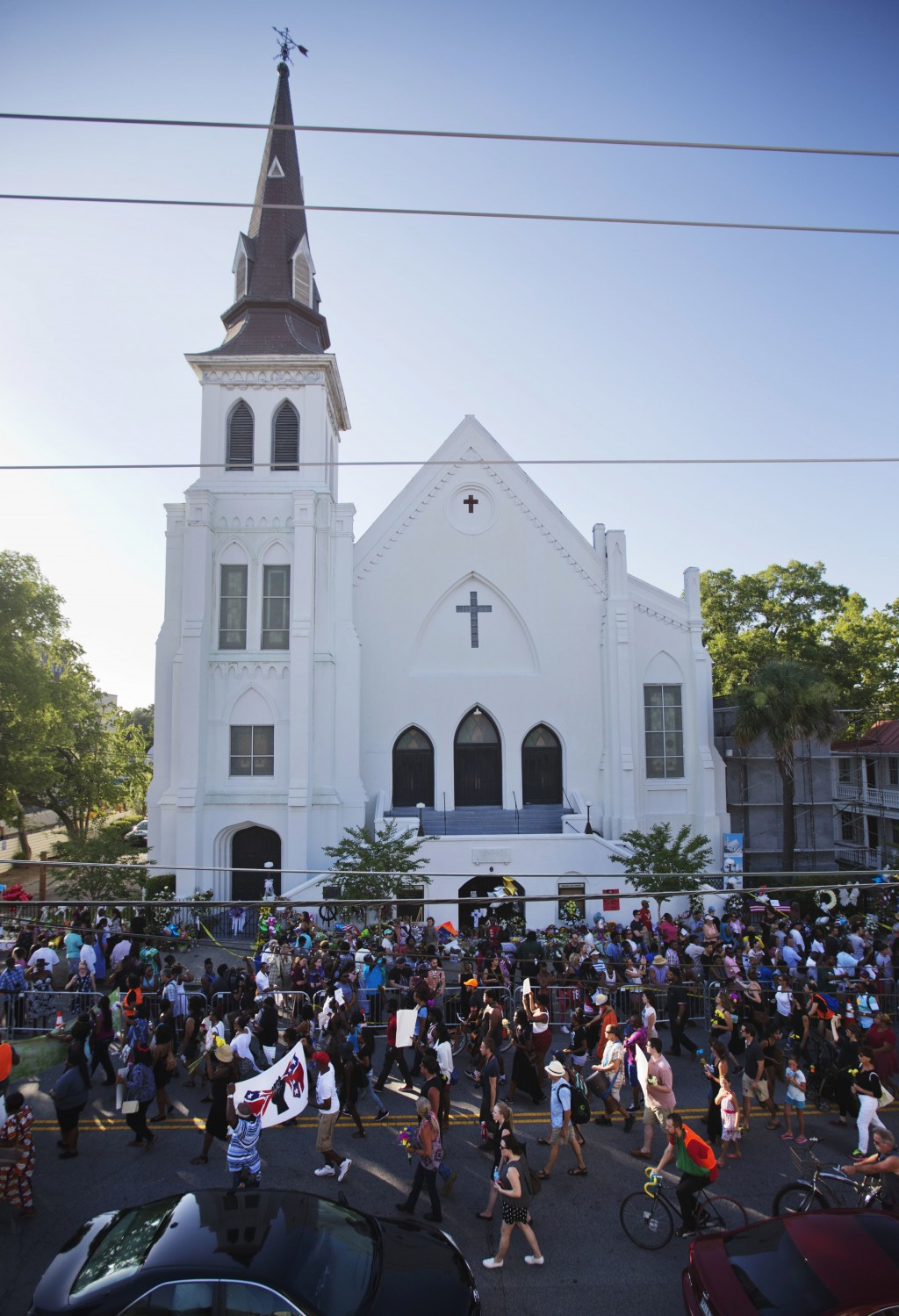 FILE - In this June 20, 2015, file photo, people march in memory of the Emanuel AME Church shooting victims in Charleston, S.C. The historic South Car...