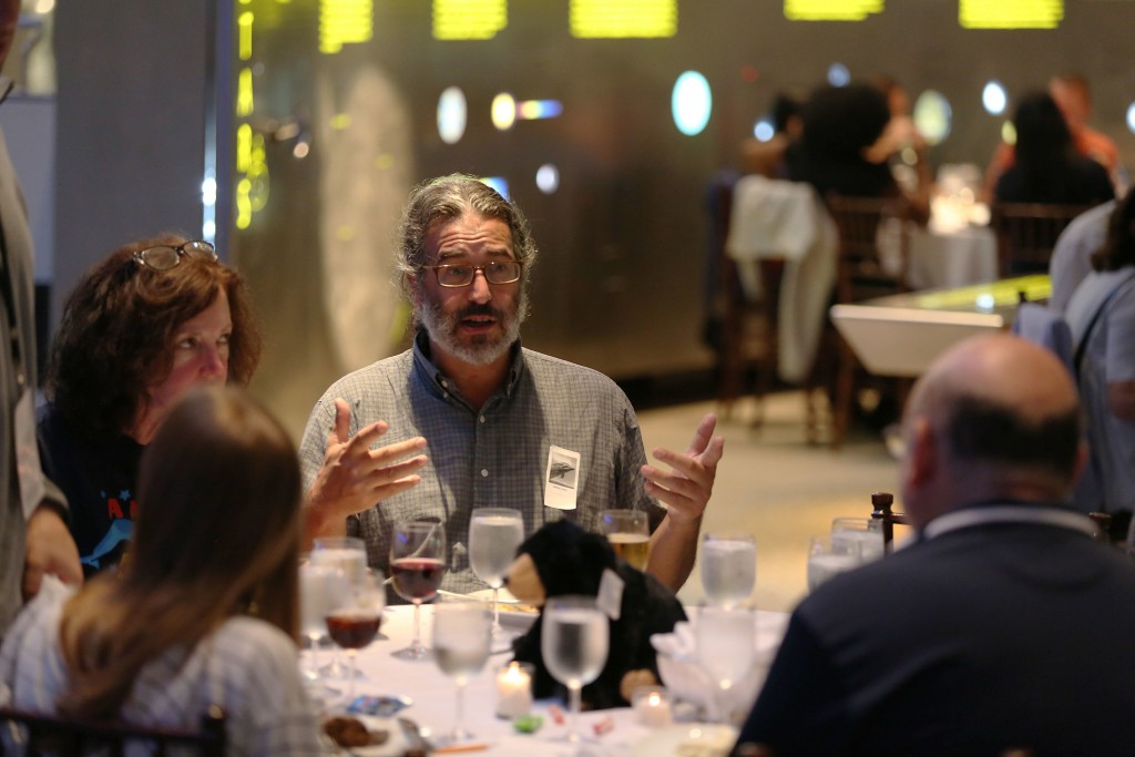 Michael Nedell, center, eats dinner in the Hall of the Universe at the adult-only sleepover on Friday, June 22, 2018, in New York. Nedell, 53, recalle...