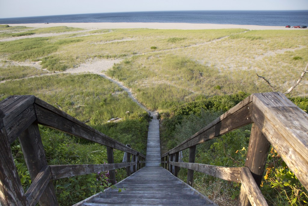 In this July 14, 2014, photo taken at Nauset Beach in Orleans, Mass., a boardwalk leads down to the beach where a German World War I submarine attack