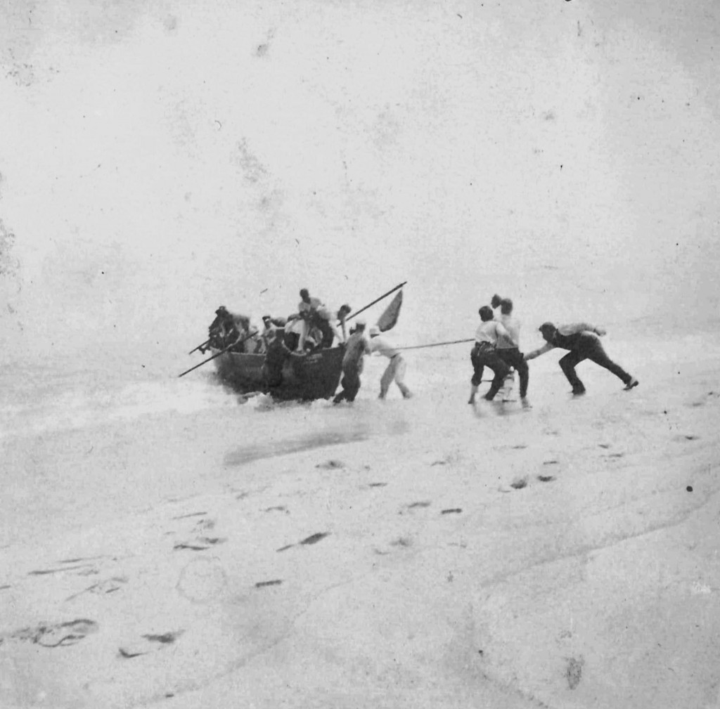 In this photo provided by the Orleans Historical Society, people help survivors arriving on a lifeboat on the shore after a German World War I submari