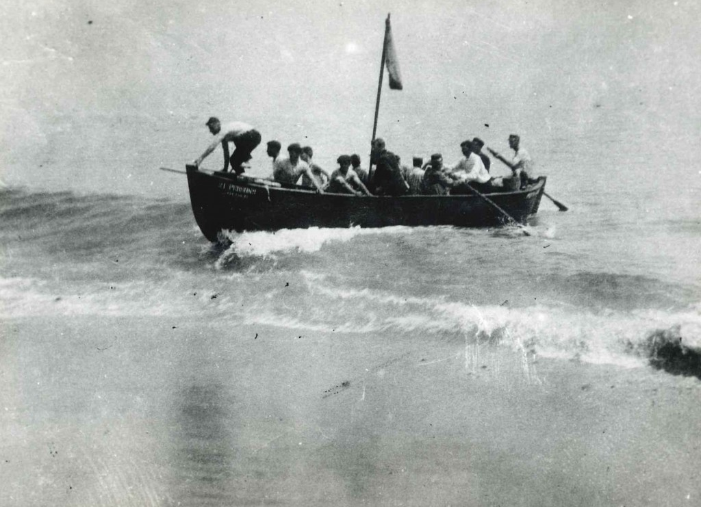 In this photo provided by the Orleans Historical Society, survivors of a German World War I submarine attack arrive in a lifeboat to the shore in Orle