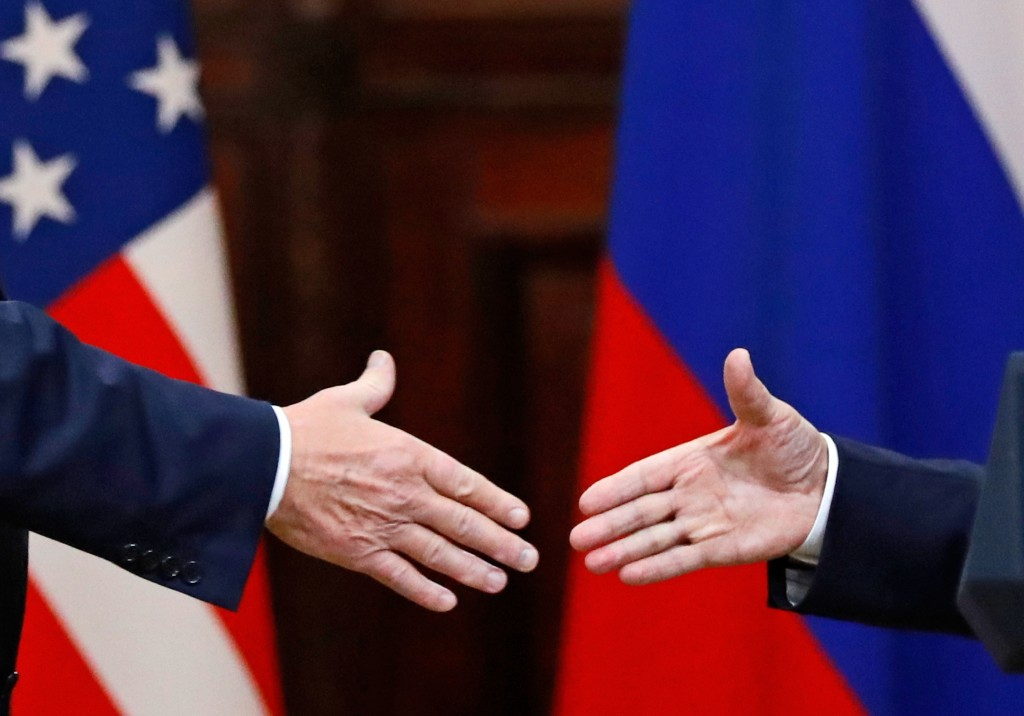 U.S. President Donald Trump shakes hand with Russian President Vladimir Putin at the end of the press conference after their meeting at the Presidenti...