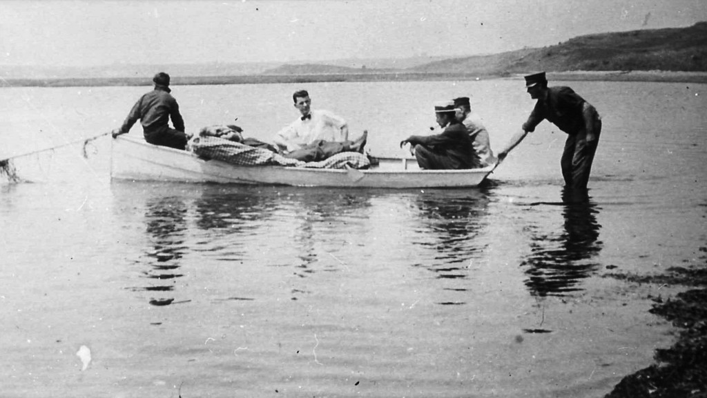 In this photo provided by the Orleans Historical Society, injured crewman John Bogovich is transported to the beach after a German World War I submari