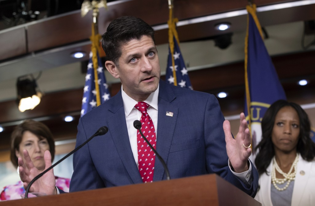Speaker of the House Paul Ryan, R-Wis., flanked by Rep. Cathy McMorris Rodgers, R-Wash., left, and Rep. Mia Love, R-Utah, talks to reporters following...