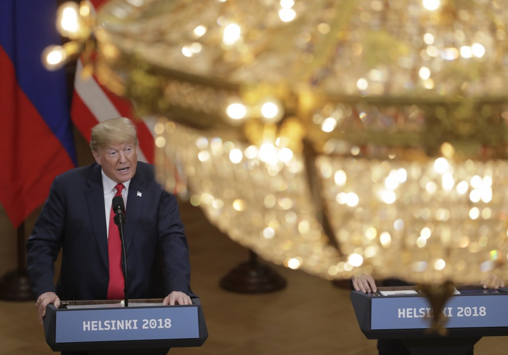 U.S. President Donald Trump speaks during a press conference after the meeting of U.S. President Donald Trump and Russian President Vladimir Putin at ...