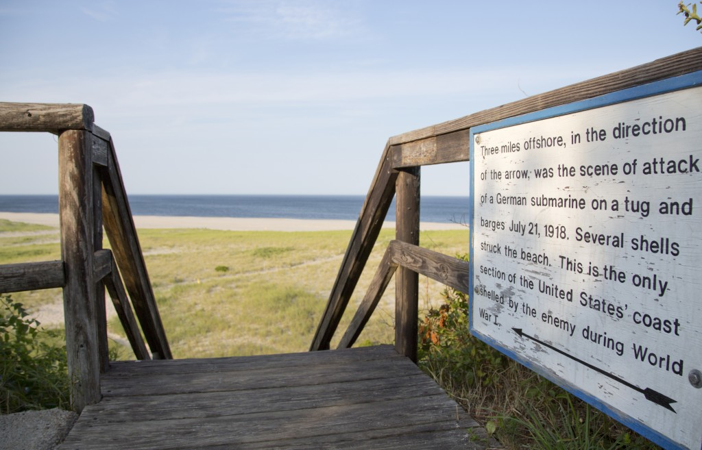 In this July 14, 2014, photo, taken at Nauset Beach, in Orleans, Mass., a sign informs visitors of a German World War I submarine attack off the shore