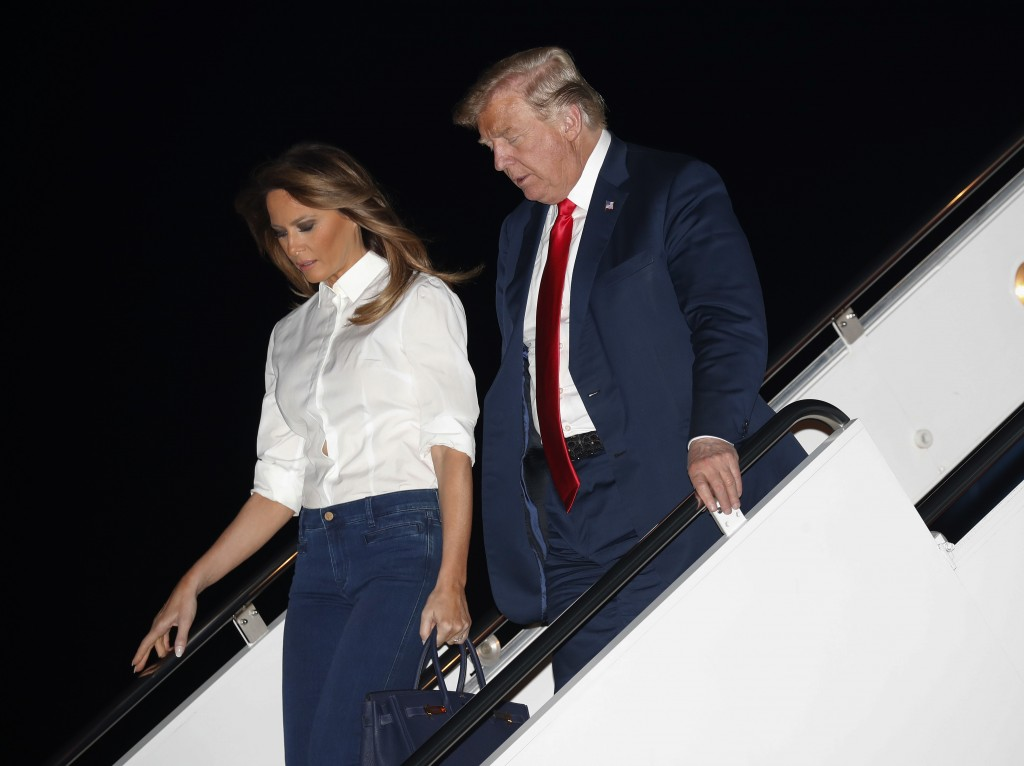 President Donald Trump and first lady Melania Trump walk down the stairs of Air Force One during their arrival, Monday, July 16, 2018, at Andrew Air F...