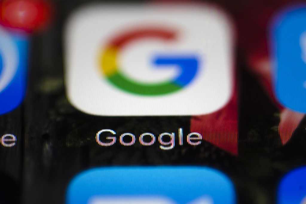 FILE  - This Wednesday, April 26, 2017 file photo shows a Google icon on a mobile phone, in Philadelphia. European Union antitrust chief Margrethe Ves