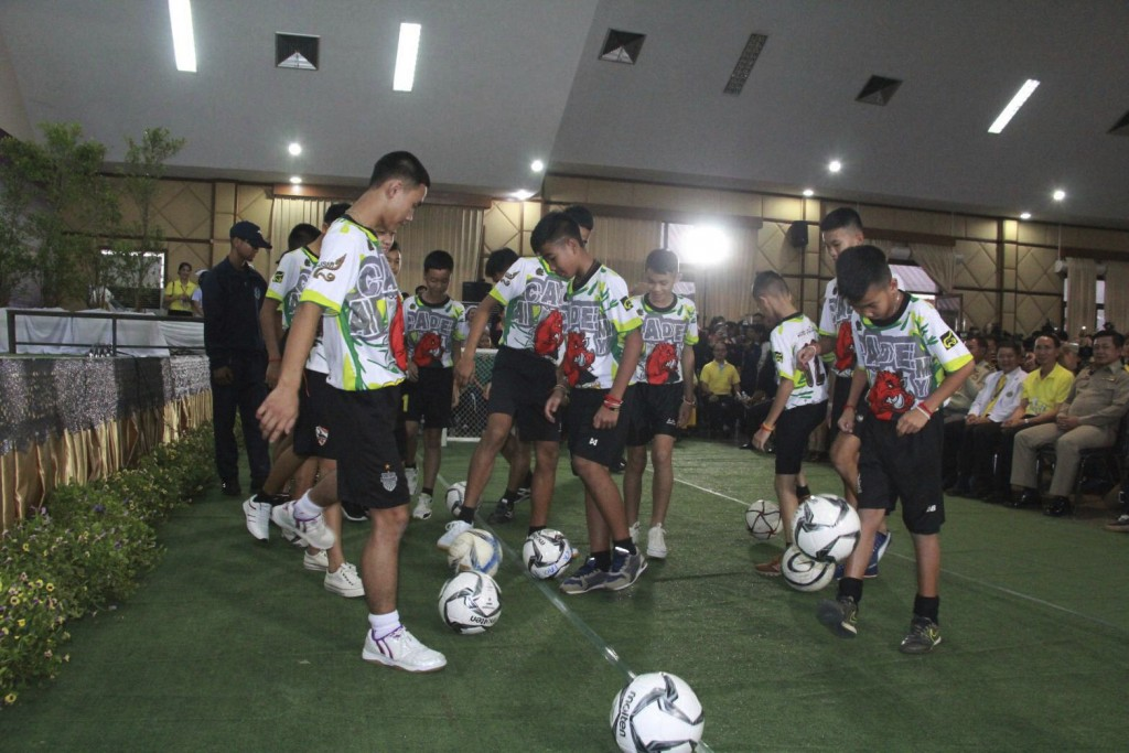 In this July 18, 2018, photo provided by Chiang Rai Public Relations Department, members of the rescued soccer team show their skills before a press c...