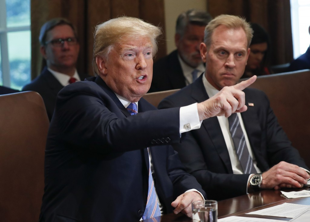President Donald Trump gestures while speaking during his meeting with members of his cabinet in Cabinet Room of the White House in Washington, Wednes...