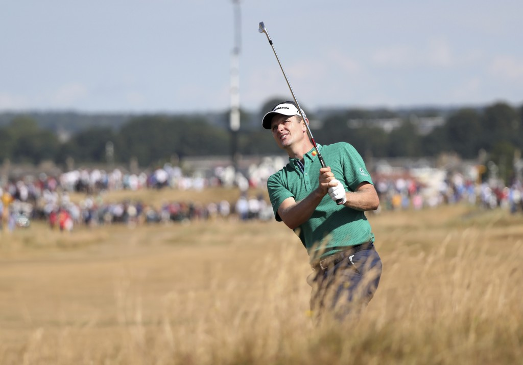Justin Rose of England plays a shot on the 2nd hole during the first round of the British Open Golf Championship in Carnoustie, Scotland, Thursday Jul...