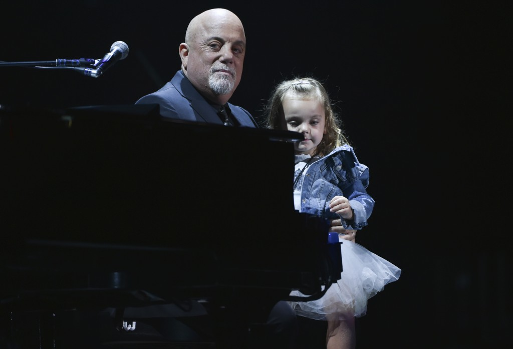 Musician Billy Joel sits with his daughter Della Rose Joel during his 100th lifetime performance at Madison Square Garden on Wednesday, July 18, 2018,...