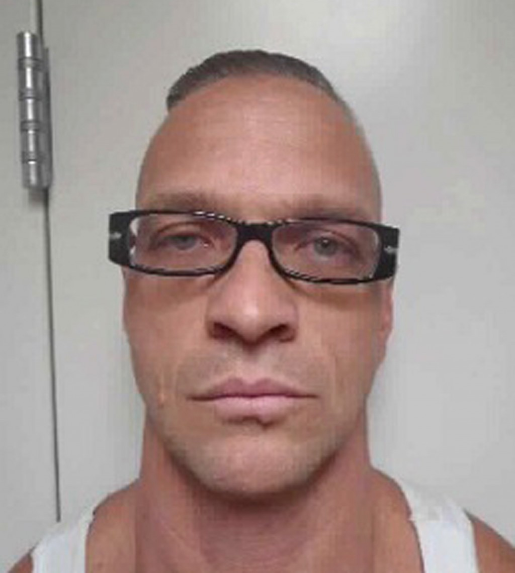 FILE - This undated file photo provided by Nevada Department of Corrections photo shows death row inmate Scott Raymond Dozier, who was convicted in 20...