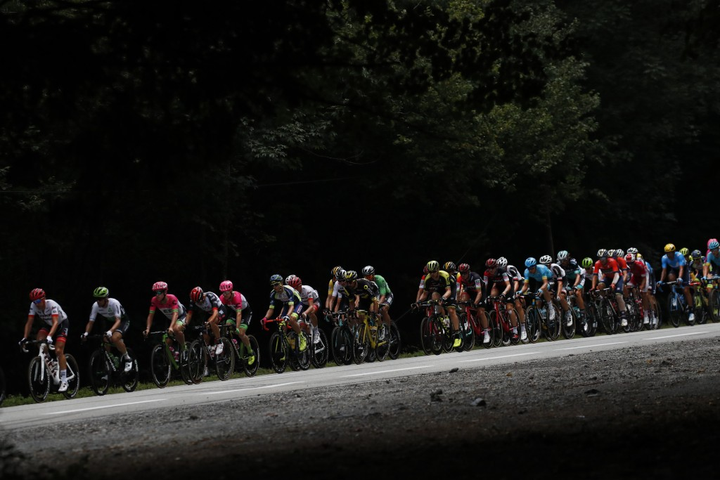 The pack passes during the thirteenth stage of the Tour de France cycling race over 169.5 kilometers (105.3 miles) with start in Bourg d'Oisans and fi...