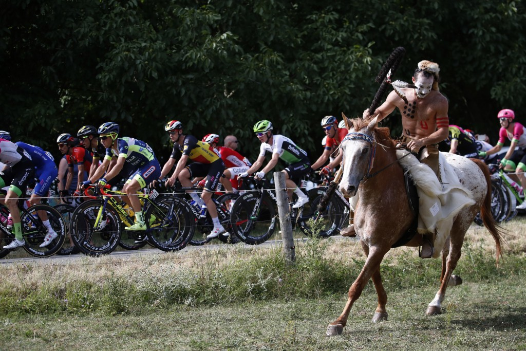 A man rides his horse along the pack during the thirteenth stage of the Tour de France cycling race over 169.5 kilometers (105.3 miles) with start in