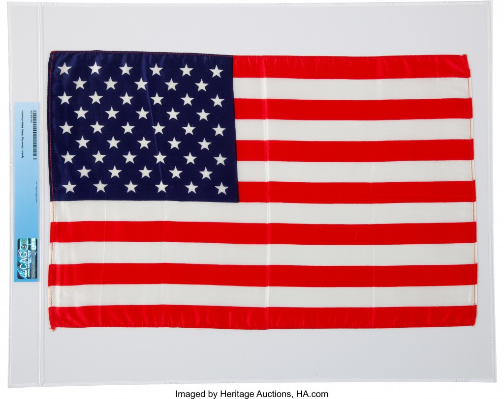 This undated photo provided by Heritage Auctions shows a U.S. flag, that traveled to the moon with Apollo 11 in July 1969. When Neil Armstrong became ...