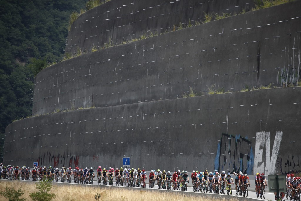 The pack rides during the thirteenth stage of the Tour de France cycling race over 169.5 kilometers (105.3 miles) with start in Bourg d'Oisans and fin...