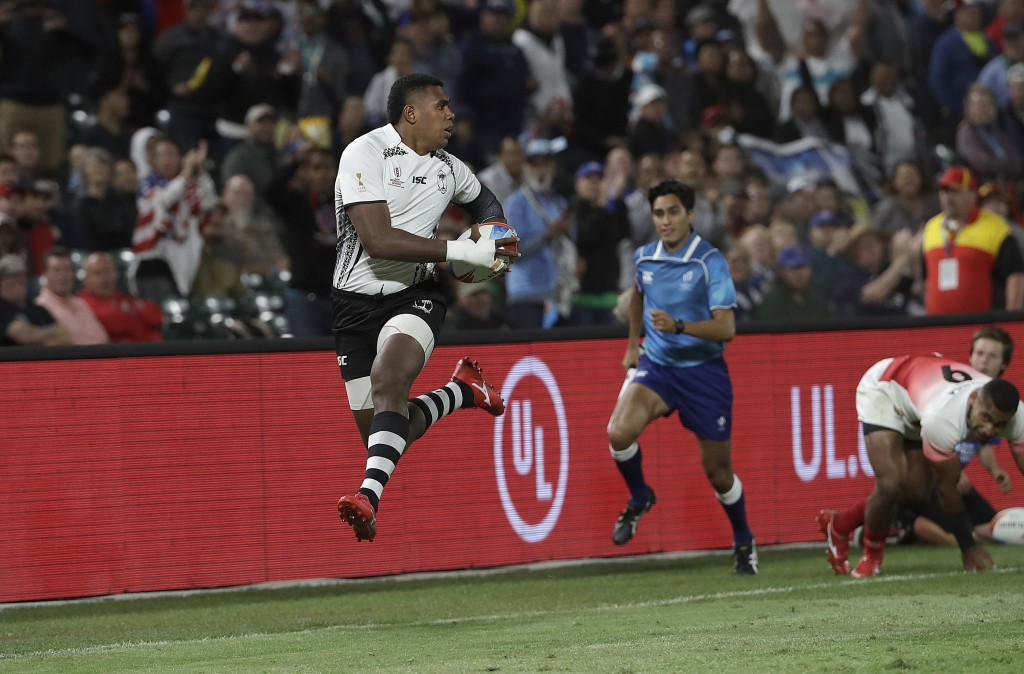 Fiji's Kalione Nasoko runs against Japan during the Rugby Sevens World Cup in San Francisco Friday