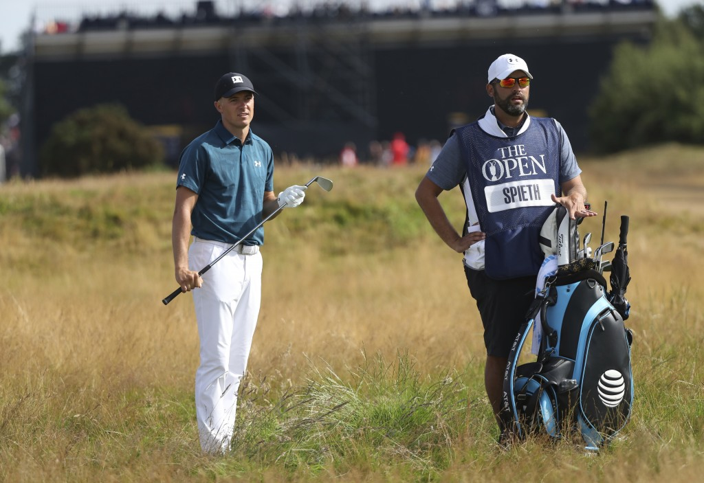 Jordan Spieth of the US prepares to play out of the rough on the 9th hole during the third round of the British Open Golf Championship in Carnoustie, ...