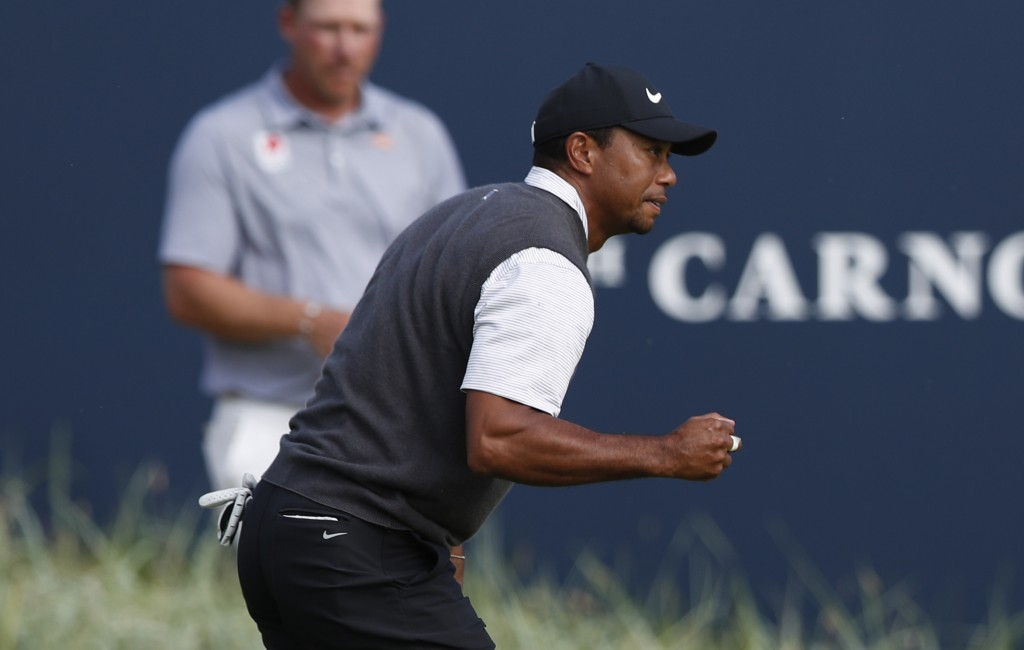 Tiger Woods of the US watches his putt on the 18th hole during the third round of the British Open Golf Championship in Carnoustie Scotland Saturday